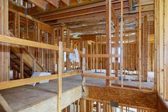 Interior framing of a new house under construction. Interior wood framing of a new house under construction royalty free stock photos