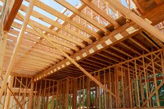 Interior framing of a new house under construction. New construction home framing royalty free stock image