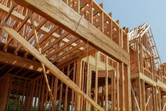Interior framing of a new house under construction. New house under construction interior framing of a single family home royalty free stock image