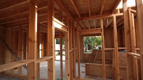 Interior framing of a new house under construction stock video footage