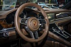 Interior of the full-size luxury car Porsche Panamera Turbo, 2016. Royalty Free Stock Photography