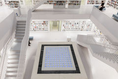 Interior of futuristic Library in white with staircases. Royalty Free Stock Images