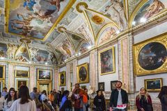 Interior of the Gallery Borghese, Rome, Italy. Rome, Italy – March 21, 2018: Borghese Gallery, tourists looking interiors and painting, sculpture royalty free stock images