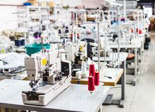 Interior of garment factory shop. Closes making atelier with several sewing machines. Tailoring industry, fashion designer workshop, industry concept Stock Image