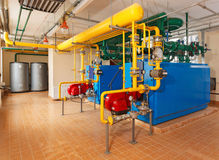 Interior gas boiler house with a lot of industrial boilers, pipe Royalty Free Stock Image