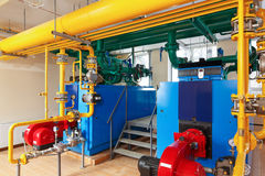 Interior gas boiler house with a lot of industrial boilers, pipe. S and pumps royalty free stock image