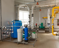 Interior gas boiler house with a water treatment system, with ma. Ny pipes and sensors Stock Photos