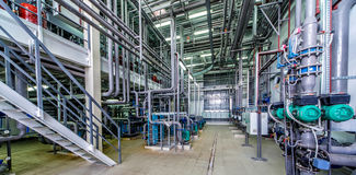 Interior gas boiler room with multiple pipelines Royalty Free Stock Photos