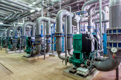 Interior gas boiler room with multiple pipelines and pumps; Royalty Free Stock Image