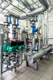 Interior gas boiler room with multiple pumps and piping Stock Image