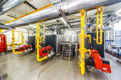 Interior gas boiler with three boilers.  royalty free stock images