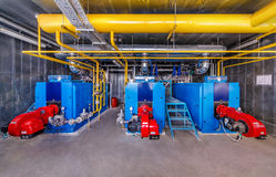 Interior gas boiler with three boilers.  royalty free stock photography