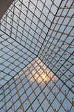 Interior of the glass Pyramid at the Louvre Royalty Free Stock Image