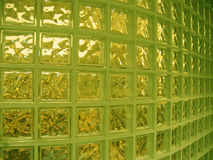 Interior glass wall. Wall made out of glass bricks in a department store in Tokyo. Increased green and yellow levels Stock Image
