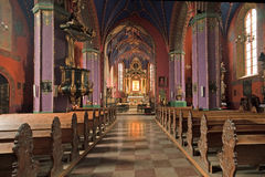 The interior of a Gothic church, Poland. Catholic church built in the fifteenth century in the Gothic style. Diocese Cathedral, the Shrine of Our Lady of Stock Image