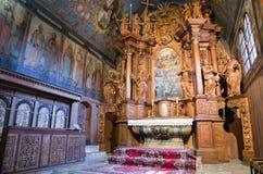 Interior of Gothic church in Tvrdosin, Slovakia. Wooden altar in historical gothic church in Tvrdosin, Slovakia stock photo