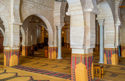 The interior of the Grand Mosque. SOUSSE, TUNISIA - SEPTEMBER 6, 2015: The interior of the Grand Mosque with many rows of stone arcades and ancient columns, on Royalty Free Stock Photography