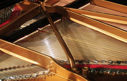 Interior of grand piano. Concert grand piano interior wide orientation Royalty Free Stock Photo