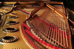 Interior of grand piano. Concert grand piano interior wide orientation Royalty Free Stock Images