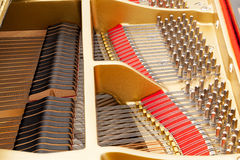 Interior of grand piano with strings Royalty Free Stock Image