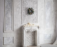 Interior with grey fretwork background, fireplace and christmas Stock Photos