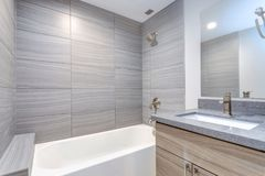 Interior of grey modern bathroom stock image