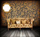 Interior grunge room with classic sofa Royalty Free Stock Image
