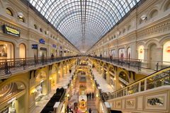Interior of GUM mall at Red Square at dusk time Stock Image