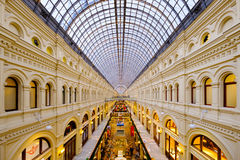 Interior of GUM mall at Red Square at dusk time Stock Images