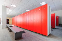Interior of gym locker room. Red, grey and white colored stock photos