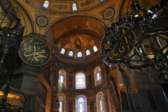Interior of the Hagia Sophia - also called Aya Sophia, in Istanbul, Turkey. With christian fresco and islamic symbols together Royalty Free Stock Photos