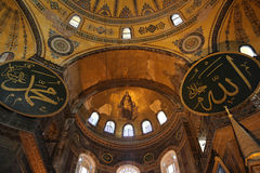 Interior of the Hagia Sophia - also called Aya Sophia, in Istanbul, Turkey. With christian fresco and islamic symbols together Stock Image