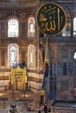 Interior of the Hagia Sophia in Istanbul, Turkey. Interior of the Hagia Sophia of Istanbul.Ancient caligraphic Quranic words are on the walls royalty free stock photography