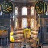 Interior of Hagia Sophia museum in Istanbul, Turkey. Interior of the Hagia Sophia of Istanbul. Ancient caligraphic Quranic words are on the walls. Hagia Sophia stock photos