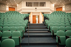 Interior of the hall for holding conferences. Rows of chairs for the audience and stage. Focus on the chairs Stock Photo
