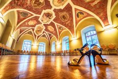 Interior: a hall with paintings,  tango shoes in the foreground Royalty Free Stock Photo
