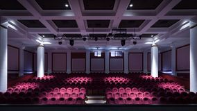 The interior of the hall in the theater. Concert hall of the theater with red new chairs. The interior of the hall in the theater or cinema view from the stage Stock Images