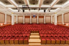 The interior of the hall in the theater. Concert hall of the theater with red new chairs. The interior of the hall in the theater or cinema view from the stage Royalty Free Stock Images