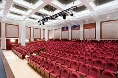 The interior of the hall in the theater. Concert hall of the theater with red new chairs. The interior of the hall in the theater or cinema view from the stage Stock Photography