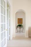 Interior Hallway. With white ceramic tile flooring stock photo