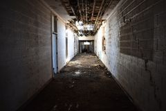 Interior hallway of an old abandoned school royalty free stock images