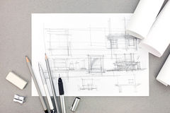 Interior hand drawing renovation concept with paper rolls and pe Royalty Free Stock Images