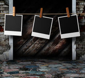 Interior with hanging instant photo frames Stock Image