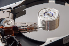 The interior of the hard disk on a black background Stock Photos