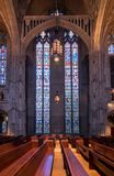 Interior of Heinz Chapel at University of Pittsburgh. PITTSBURGH, PA - 5 JULY 2018: Tall high stained glass windows inside Heinz Chapel at the University of royalty free stock images