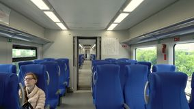 Interior of the high-speed train swallow with passengers on seats. Moscow, Russian Federation – July 15, 2017: modern interior of the high-speed train swallow stock footage