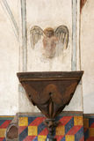 Interior of Historic Spanish Mission. Detail of angel on interior wall of historic Spanish mission stock photo