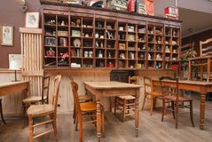 Interior of historical restaurant with vintage decor, wooden furniture and retro details inside Stock Photos