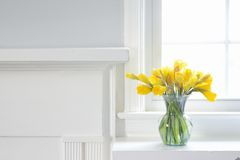 Interior Home decor of Yellow Daffodils on white mantle Royalty Free Stock Photos