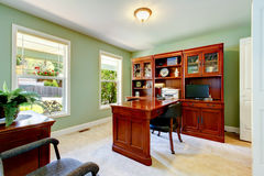 Interior of home office with ivory walls, desk and cabinet. Stock Photography
